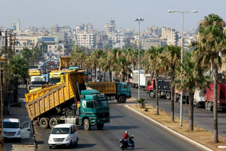 Truck drivers block roads in Beirut to protest fuel shortages due to Lebanon's deepening economic crisis