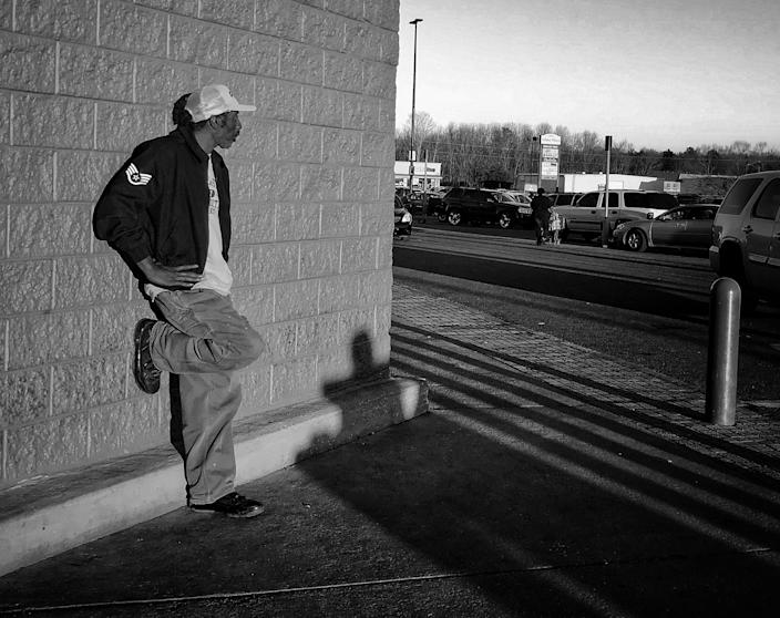 A man stands outside Walmart, one of the few thriving businesses and major employers in Selma. (Photo: Holly Bailey/Yahoo News)