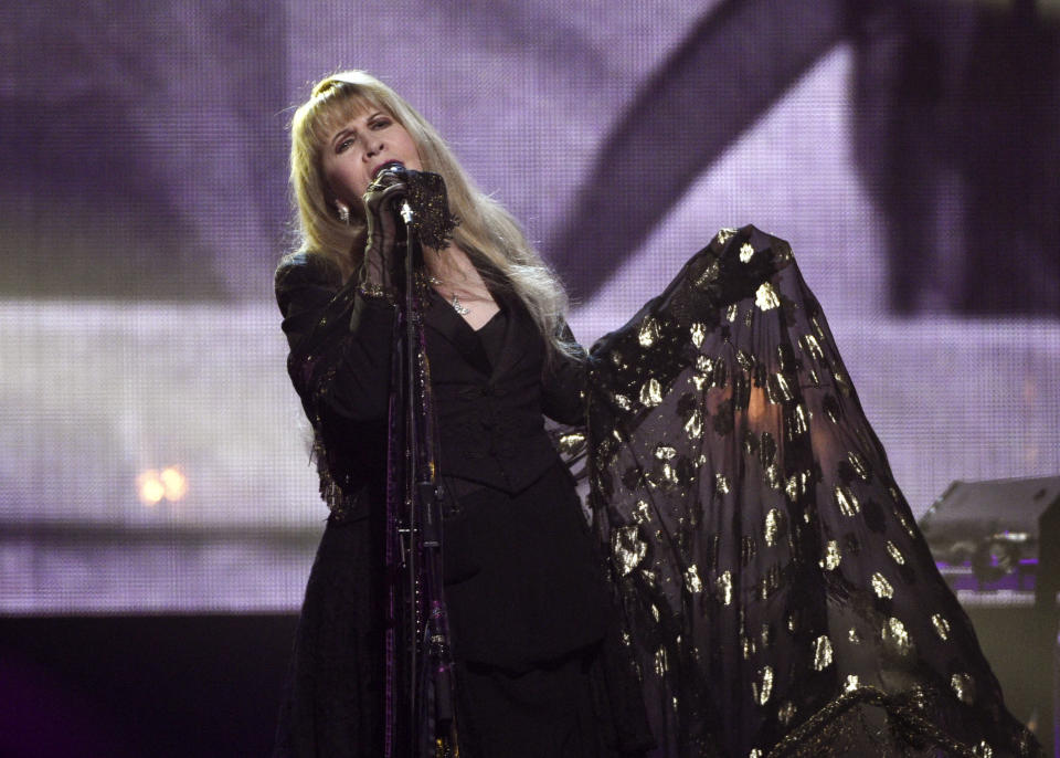 """FILE - Stevie Nicks performs at the Rock & Roll Hall of Fame induction ceremony in New York on March 29, 2019. Nicks has spent the last 10 months homebound, mainly due to the coronavirus pandemic. During that time, she recorded the new single """"Show Them the Way"""" and edited her new concert film """"Stevie Nicks 24 Karat Gold The Concert."""" The song will be released Friday and the concert film, recorded over two nights during Nicks' 2016-17 """"24 Karat Gold"""" tour, will be available at select theaters and drive-ins on Oct. 21 and 25. (Photo by Evan Agostini/Invision/AP, File)"""