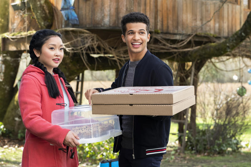 "In this undated image provided by Netflix is Lana Condor, left, and Jordan Fisher in a scene from the film, ""To All The Boys: P.S. I Still Love You."" (Bettina Strauss/Netflix via AP)"