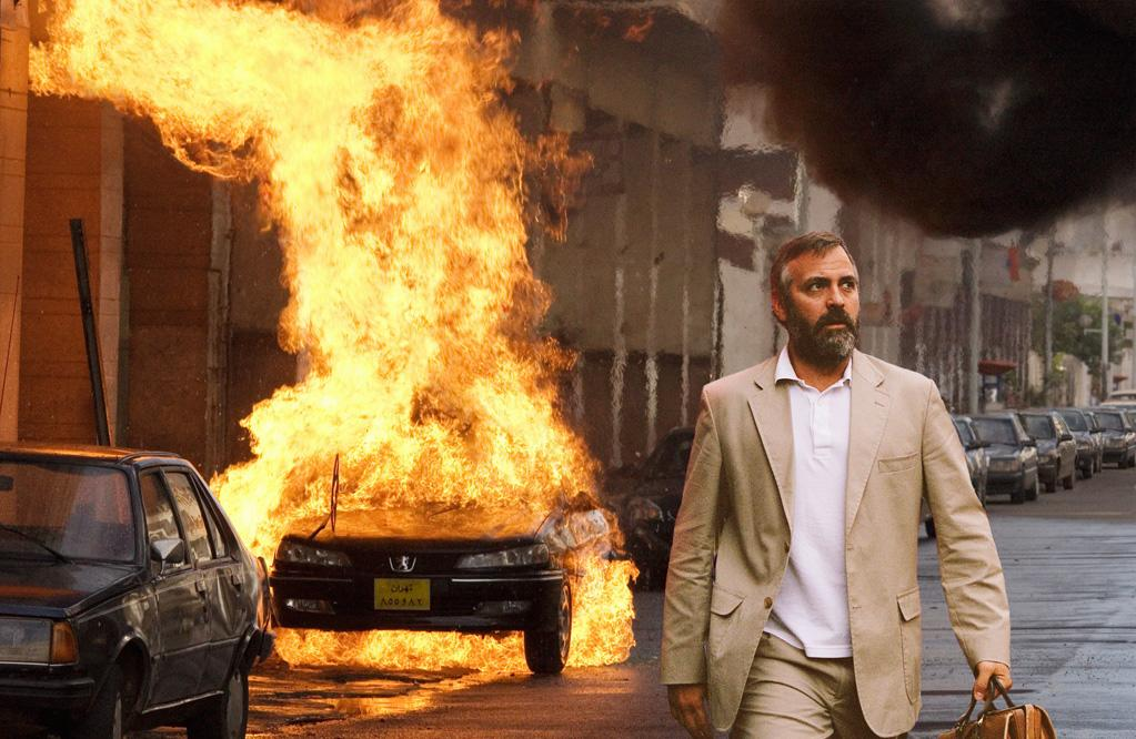 """<a href=""""http://movies.yahoo.com/movie/1808631296/info"""">Syriana</a> (2005): Clooney famously cast aside his dashing good looks, gaining 30 pounds in 30 days, growing a beard and shaving his hairline to play Bob Barnes, a fictionalized version of former CIA officer Robert Baer. He was unrecognizable, a crucial piece in writer-director Stephen Gaghan's dense and complicated film about the global oil industry, and the performance earned him the Academy Award for best supporting actor. Clooney was so dedicated, he severely injured his back shooting a torture scene, and was still hurt while directing and co-starring in """"Good Night, and Good Luck."""" This is a prime example of his willingness to reject the glamour of being a movie star in favor of doing smart, challenging work."""