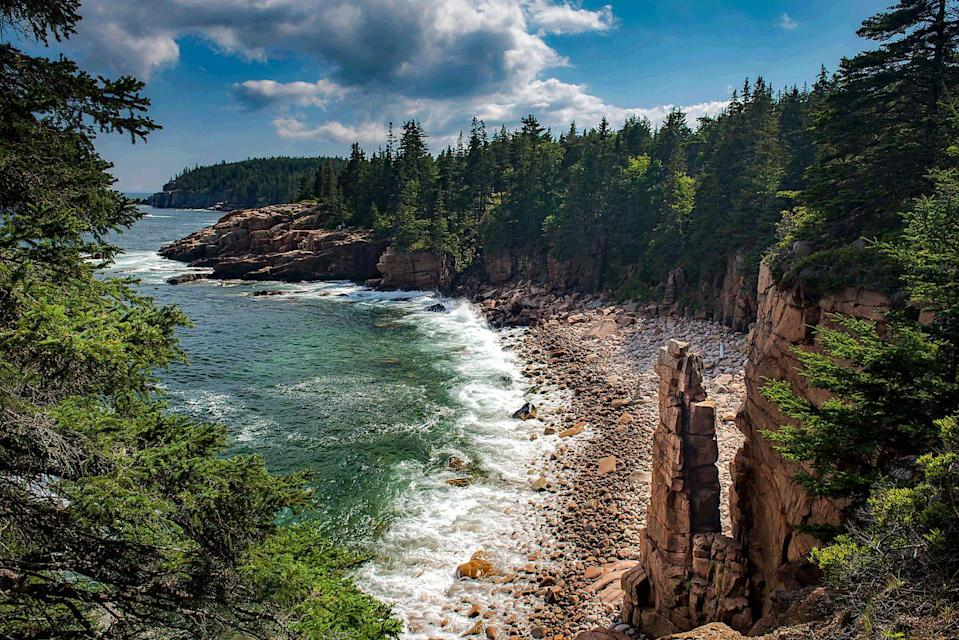 """<p>The rugged beauty of coastal Maine meets the serene atmosphere of emerald forests at Acadia National Park. The Victorian-era village of Bar Harbor serves as the perfect home base, as it's in easy reach of Acadia's beloved Park Loop Road and Cadillac Mountain. </p><p>The national park also houses a number of well-curated museums including the Smithsonian-affiliated <a href=""""https://www.abbemuseum.org/"""" rel=""""nofollow noopener"""" target=""""_blank"""" data-ylk=""""slk:Abbe Museum"""" class=""""link rapid-noclick-resp"""">Abbe Museum</a>, which shines a light on the Wabanaki Alliance of Native American tribes. In the off-season, Acadia transforms into an autumn dream, with rich oranges, yellows, and reds covering the forests. </p>"""