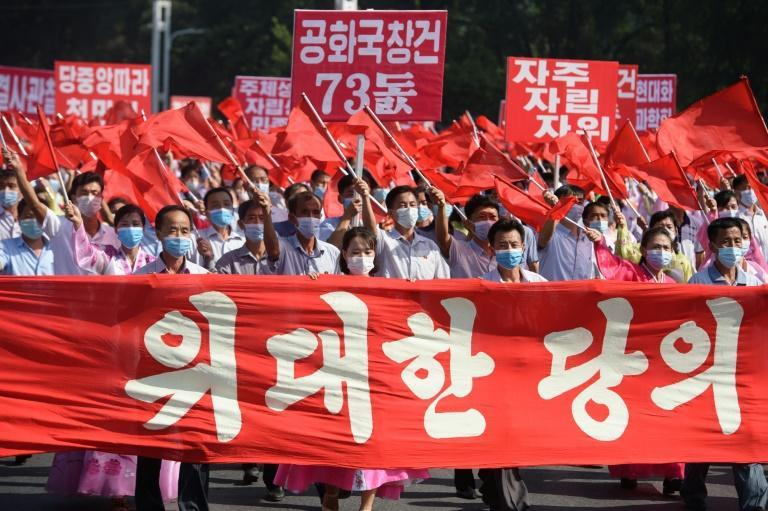 People take part in a mass demonstration in Pyongyang on September 9, 2021, to mark 73 years since the foundation of the Democratic People's Republic of Korea (AFP/KIM Won Jin)