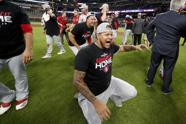 St. Louis Cardinals relief pitcher Carlos Martinez, center, celebrates with teammates after the Cardinals beat the Atlanta Braves 13-1 in Game 5 of their National League Division Series baseball game Wednesday, Oct. 9, 2019, in Atlanta. (AP Photo/John Bazemore)