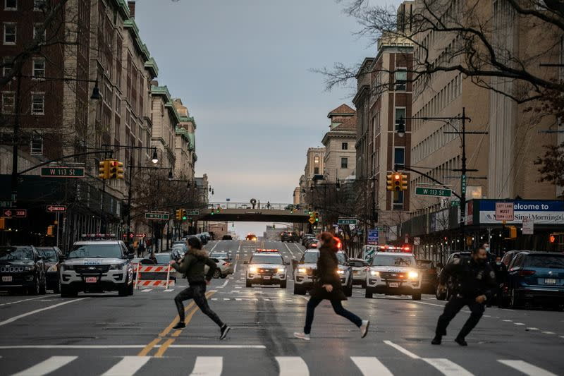 People run after a man opened fire outside the Cathedral Church of St. John the Divine in Manhattan