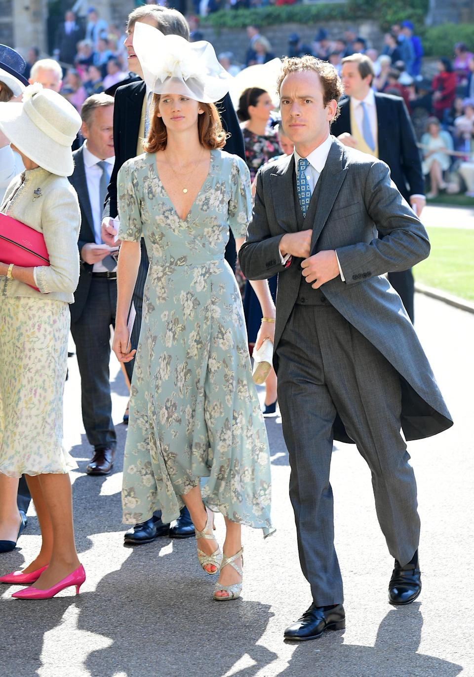 <p>Prince Harry's friend arrives wearing a grey suit while his wife Lara opts for an oversized white hat. <em>[Photo: PA]</em> </p>