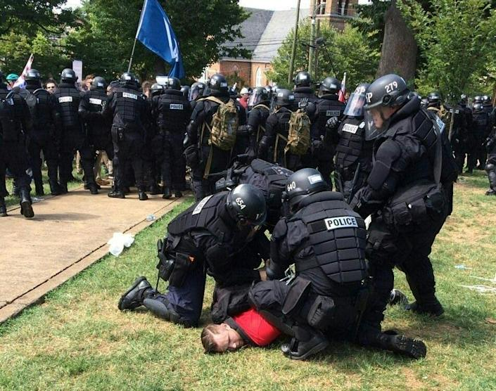 In this twitter hand-out photo courtesy the Virginia State Police, arrests are made following declaration of unlawful assembly at Emancipation Park in Charlottesville, Virginia on August 12, 2017 (AFP Photo/Virginia State Police)