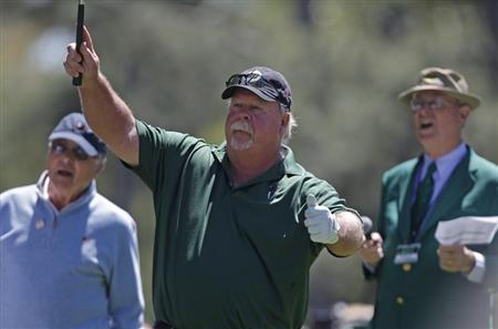 Craig Stadler (C) of the U.S. watches his hole-in-one on the first hole during the Par-3 tournament ahead of the 2011 Masters golf tournament in Augusta
