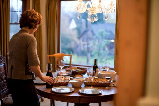 Woman setting thanksgiving table