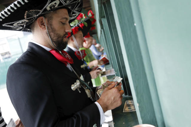 <p>Chris Stock of Chattanooga, Tenn., places bets before the 144th running of the Kentucky Derby horse race at Churchill Downs Saturday, May 5, 2018, in Louisville, Ky. (Photo: John Minchillo/AP) </p>
