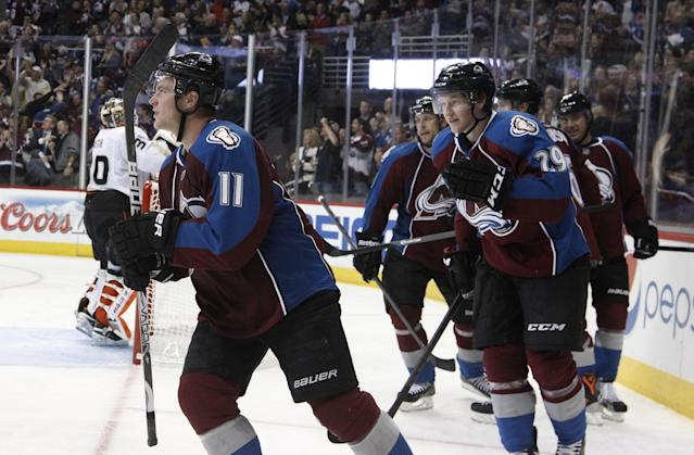 Colorado Avalanche left wing Jamie McGinn, left, celebrates his goal with rookie center Nathan MacKinnon against the Anaheim Ducks in the third period of the Avalanche's 6-1 victory in a hockey game in Denver on Wednesday, Oct. 2, 2013. (AP Photo/David Zalubowski)