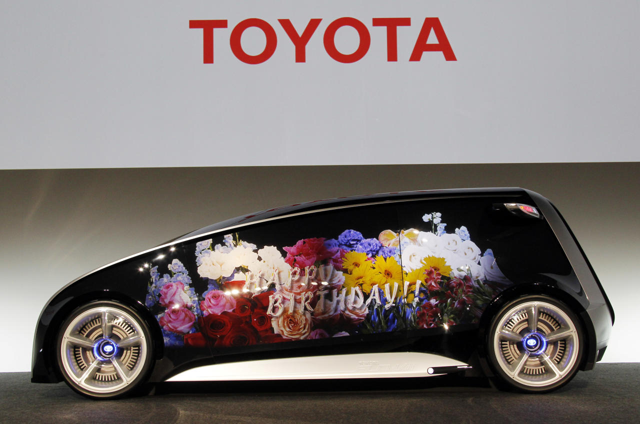 A Toyota Fun-Vii with its whole body can be used as a display space is shown in Tokyo Monday, Nov. 28, 2011. Toyota Motor Corp. unveiled the futuristic concept car resembling a giant smartphone to demonstrate how Japan's top automaker is trying to take the lead in technology at the upcoming Tokyo auto show. The car works like a personal computer and allows drivers to connect with dealers and others with a tap of a touch-panel door. (AP Photo/Koji Sasahara)