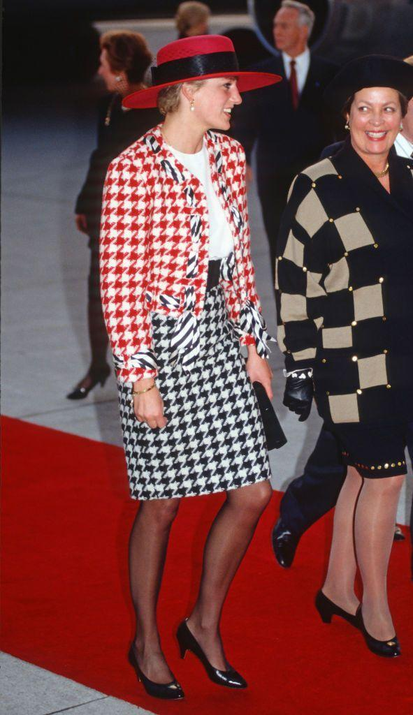 <p>How do you wear houndstooth without looking stodgy? Mix colors. Princess Diana's black, white, and red Moschino suit was bold yet elegant. </p>