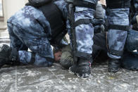 FILE - In this Sunday, Jan. 31, 2021 file photo, police officers detain a man during a protest against the jailing of opposition leader Alexei Navalny in Moscow, Russia. A prison sentence for Navalny and a sweeping crackdown on protesters demanding his release reflect the Kremlin's steely determination to fend off threats to its political monopoly at any cost.(AP Photo/Denis Kaminev, File)