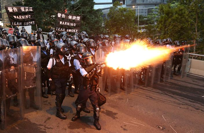 Police officers fire a tear gas during a demonstration against a proposed extradition bill in Hong Kong, China June 12, 2019. (Photo: REUTERS/Athit Perawongmetha)