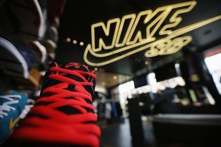 Shoes are displayed in the Nike store in Santa Monica, California, September 25, 2013. NIKE, Inc. plans to release its first quarter fiscal 2014 financial results on Thursday, September 26, 2013. REUTERS/Lucy Nicholson