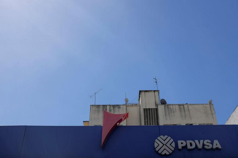 FILE PHOTO: The corporate logo of the Venezuelan state-owned oil company PDVSA is seen at a gas station in Caracas