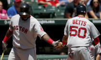 Boston Red Sox Mookie Betts (50) is congratulated by Pablo Sandoval after scoring a run on an RBI single hit by Hanley Ramirez during the first inning of a baseball game against the Texas Rangers, Sunday, May 31, 2015, in Arlington, Texas. (AP Photo/Brandon Wade)