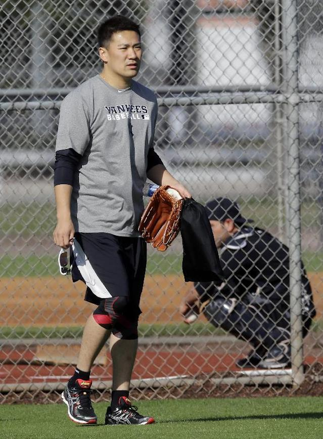 New York Yankees pitcher Masahiro Tanaka, of Japan, walks away after throwing a bullpen session during practice at the Yankees' minor league facility Thursday, Feb. 13, 2014, in Tampa, Fla. (AP Photo/Chris O'Meara)