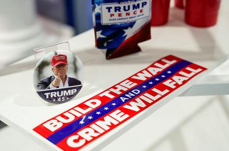 FILE PHOTO: A bumper sticker and pin are for sale at the Trump Victory booth at the Conservative Political Action Conference (CPAC) annual meeting at National Harbor in Oxon Hill, Maryland, U.S., March 2, 2019.    REUTERS/Joshua Roberts/File Photo