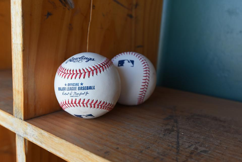 LAKELAND, FL - MARCH 01:  A detailed view of a pair of official Rawlings Major League Baseball baseballs with the imprinted signature of  Robert D. Manfred Jr., the Commissioner of Major League Baseball, sitting in the dugout prior to the Spring Training game between the New York Yankees and the Detroit Tigers at Publix Field at Joker Marchant Stadium on March 1, 2020 in Lakeland, Florida. The Tigers defeated the Yankees 10-4.  (Photo by Mark Cunningham/MLB Photos via Getty Images)