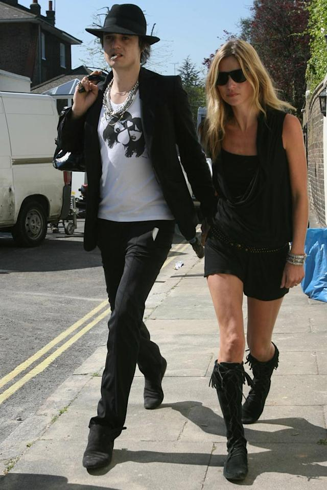 "Supermodel Kate Moss' relationship with Pete Doherty was filled with lots of ups and downs, and arrests and drug charges. Although Doherty announced they were planning to wed, Kate finally kicked the rocker of her London home in July when she suspected he was cheating on her with another model. Andy Robinson/Matt Keeble/<a href=""http://www.splashnewsonline.com/"" target=""new"">Splash News</a> - April 19, 2007"