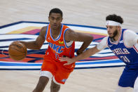 Oklahoma City Thunder guard Theo Maledon (11) goes against Philadelphia 76ers guard Seth Curry (31) during the first half of an NBA basketball game, Saturday, April 10, 2021, in Oklahoma City. (AP Photo/Garett Fisbeck)