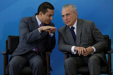 Brazil's Industry and Foreign Trade Minister Marcos Pereira speaks with Brazil's President Michel Temer during a ceremony at the Planalto Palace, in Brasilia