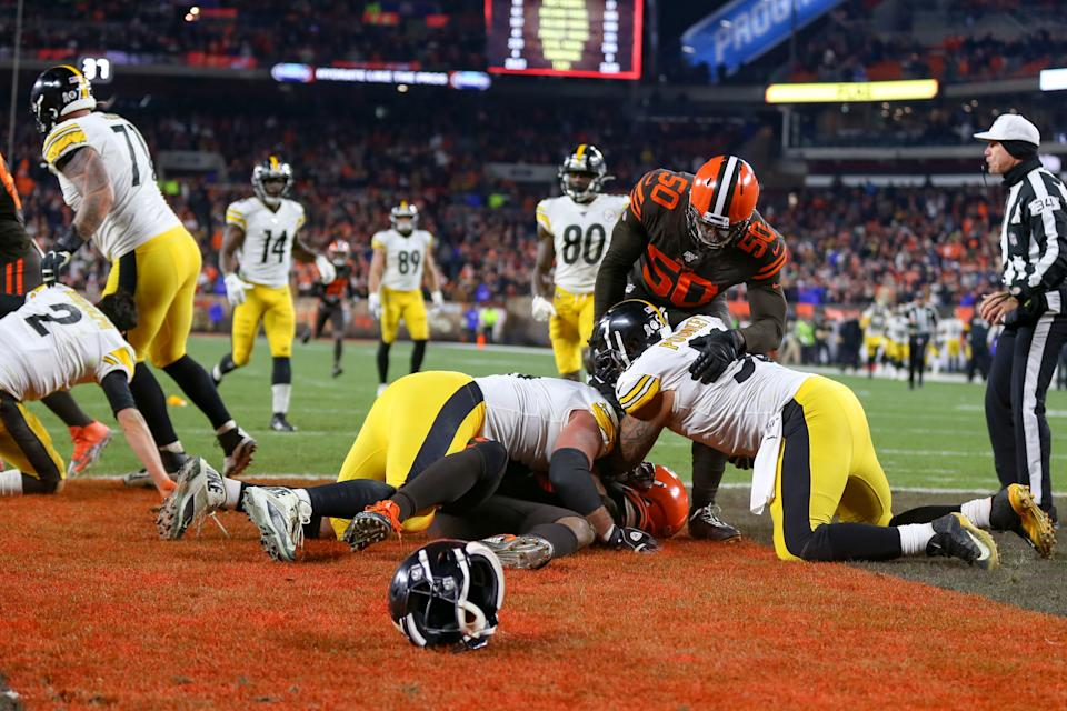 Pittsburgh Steelers center Maurkice Pouncey (53) and Pittsburgh Steelers offensive guard David DeCastro (66) take down Cleveland Browns defensive end Myles Garrett. (Photo by Frank Jansky/Icon Sportswire via Getty Images)