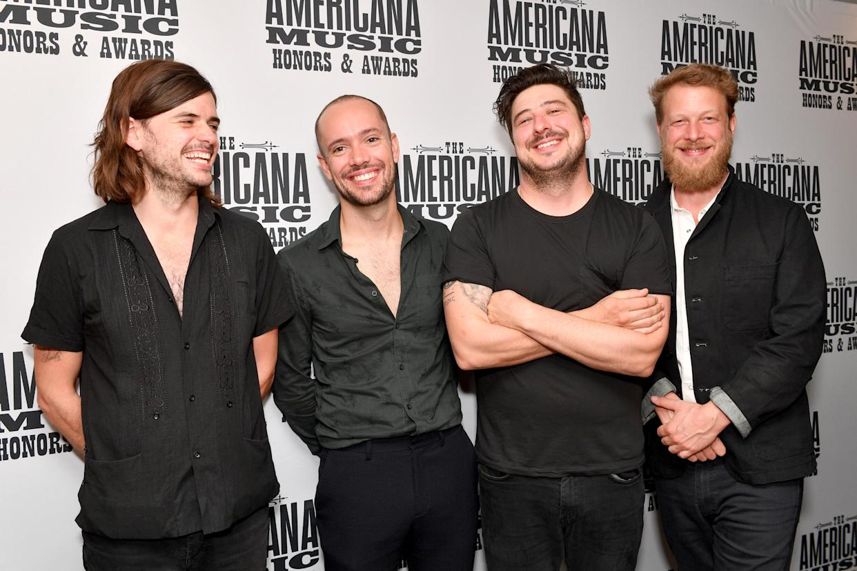 Winston Marshall (L) has left Mumford and Sons while Ben Lovett, Marcus Mumford and Ted Dwane remain in the group. (Photo by Erika Goldring/Getty Images for Americana Music Association)