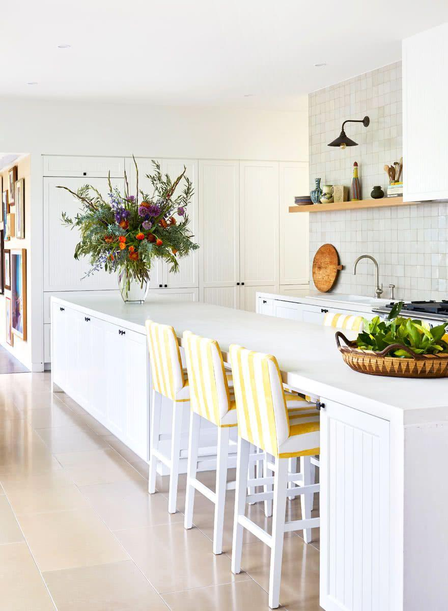 """<p>Equal parts preppy and bohemian, contemporary and timeless, this kitchen by <a href=""""https://annaspirodesign.com.au/"""" rel=""""nofollow noopener"""" target=""""_blank"""" data-ylk=""""slk:Anna Spiro Design"""" class=""""link rapid-noclick-resp"""">Anna Spiro Design</a> is an eclectic dream. A lone floating shelf in line with the bottom of the hood is visually arresting and streamlined. </p>"""