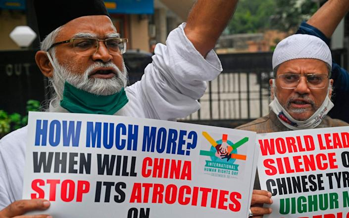 Muslims hold placards during a protest against the Chinese government's policies on Muslim Uighur minorities, in Mumbai - INDRANIL MUKHERJEE/AFP