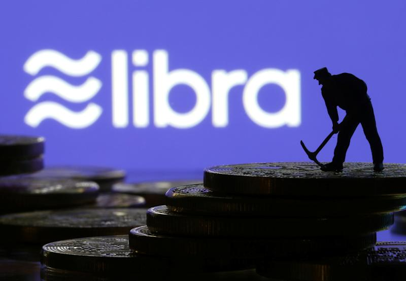 A small toy figure stands on representations of virtual currency in front of the Libra logo in this illustration picture, June 21, 2019. REUTERS/Dado Ruvic/Illustration