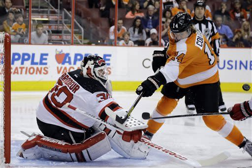 New Jersey Devils' Martin Brodeur (30) blocks a shot by Philadelphia Flyers' Sean Couturier (14) during the second period of an NHL hockey game, Thursday, April 18, 2013, in Philadelphia. New Jersey won 3-0. (AP Photo/Matt Slocum)