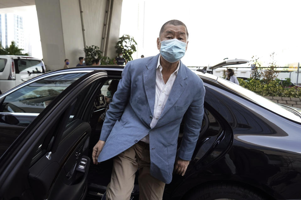 In this Thursday, Oct. 15, 2020 photo, Jimmy Lai arrives at a court in Hong Kong. Jimmy Lai, the pro-democracy Hong Kong media tycoon who was arrested during a crackdown on dissent was charged Wednesday Dec. 2, 2020, with fraud but no national security offenses, two newspapers reported. Jimmy Lai of Next Digital, which owns the Apple Daily newspaper, was among 10 people arrested Aug. 10 on what police said was suspicion of violating a national security law and collusion with a foreign country. Lai, 71, was later released on bail but police raided his company's offices in October. (AP Photo/Kin Cheung)