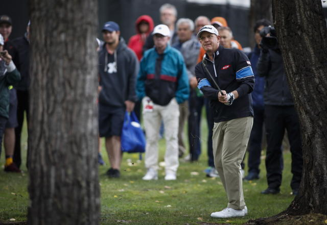 Tom Gillis, of Lake Orion, Mich., hits from the rough during the PGA Tour Champion's Shaw Charity Classic golf event in Calgary, Alberta, Sunday, Sept. 1, 2019. (Jeff McIntosh/The Canadian Press via AP)