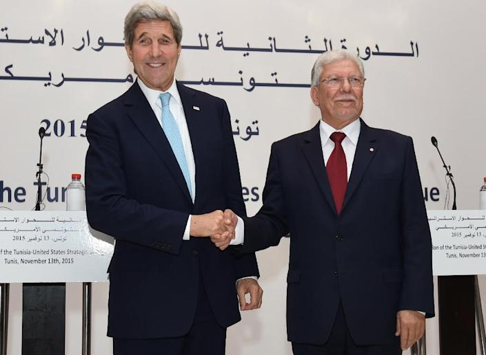 Tunisian Foreign Affairs Minister Taieb Baccouche (R) greets US Secretary of State John Kerry, on November 13, 2015 at the foreign ministry in Tunis (AFP Photo/Fethi Belaid)