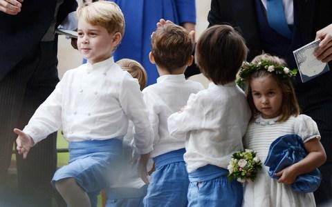 Princess Charlotte appeared unimpressed with her brother's marching game as she clutched a bag and posy of flowers after the wedding - Credit: Mark Stewart Photography