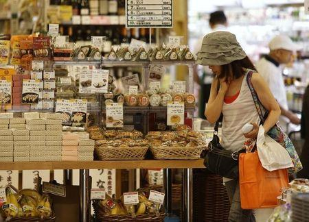 A woman looks at food products at a supermarket in Tokyo