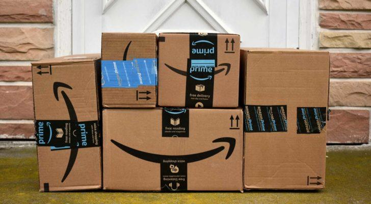stack of Amazon (AMZN) delivery boxes at a front door