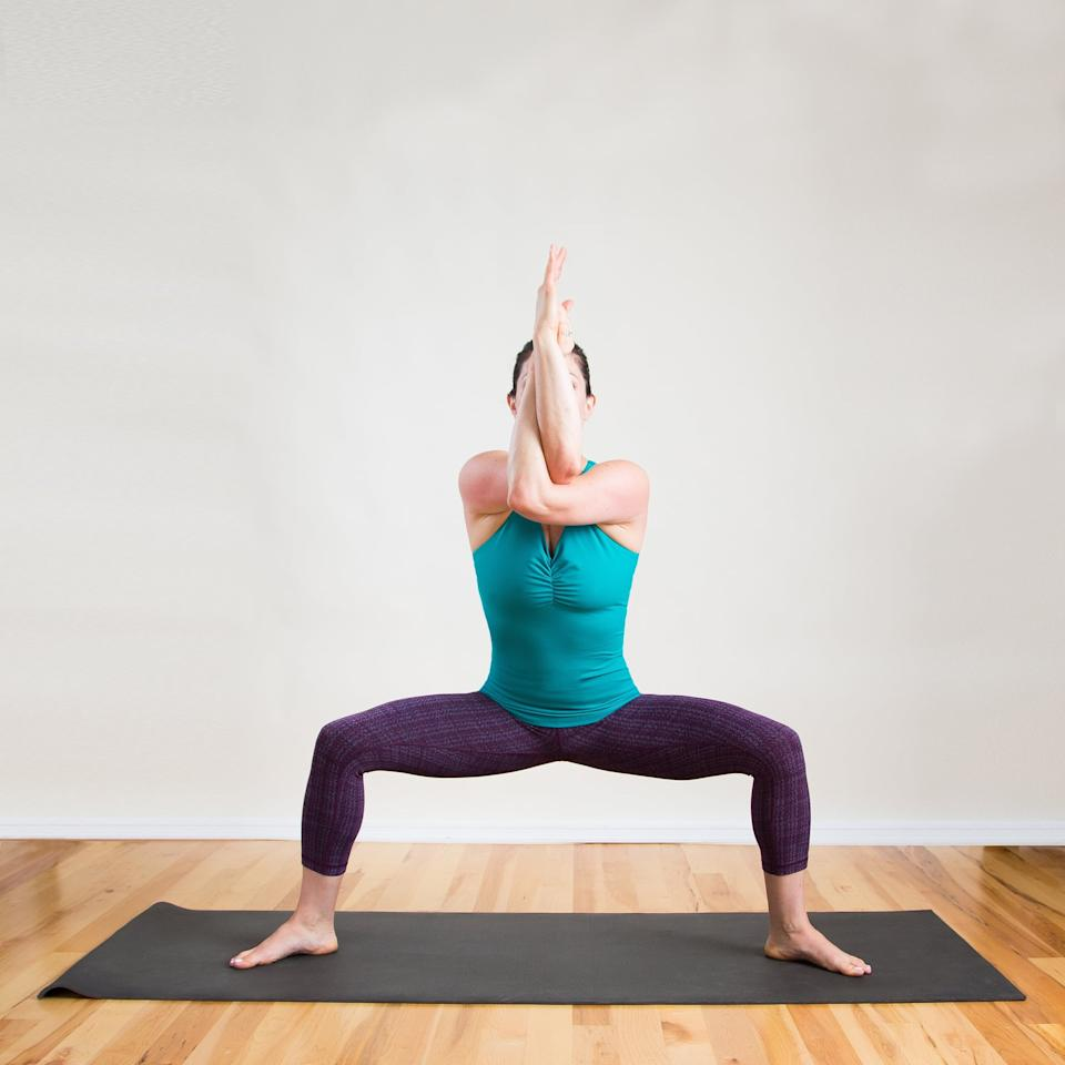 <p>This stretch allows you to stretch the upper back and shoulders while also targeting the inner thighs.</p> <ul> <li>From a standing straddle, cross the left elbow over the right, bringing the right fingers to the heel of your left palm.</li> <li>Gaze past the wrists for five breaths, staying low in your wide squat.</li> <li>Uncross the arms and switch sides for another five breaths. </li> </ul>