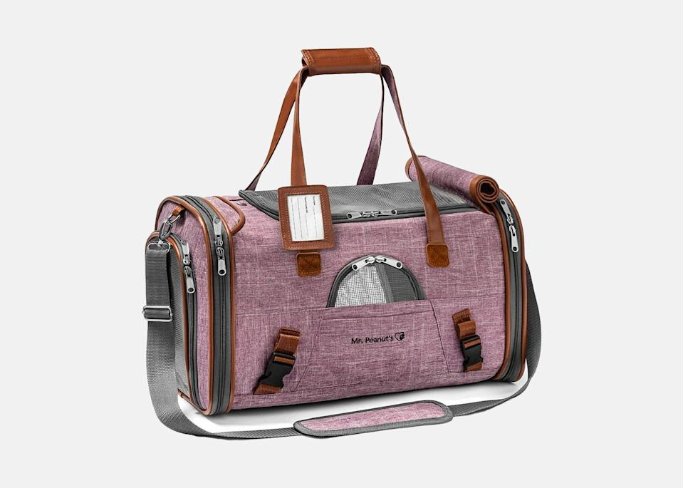 """<p>When traveling with a pet, safety is key, and this carry-on pet bag is built with that in mind. It's designed with self-locking zippers that don't slide up or down, so you won't have any worries about chasing your pet down the jetbridge. The bag also includes an ID tag holder, an interior leash attachment, and a safety seat belt in case your flight encounters unexpected rough air. Just as stylish as it is practical, the carrier features a fabric rollaway cover, faux fleece bedding, mesh windows on the top and sides, and an extra pocket. (If you often fly first or business and have slightly more room at your feet, spring for the <a href=""""https://fave.co/30D1FB7"""" rel=""""nofollow noopener"""" target=""""_blank"""" data-ylk=""""slk:expandable option"""" class=""""link rapid-noclick-resp"""">expandable option</a>.)</p> <p><strong>Buy now:</strong> <a href=""""https://fave.co/39jVPbq"""" rel=""""nofollow noopener"""" target=""""_blank"""" data-ylk=""""slk:$40, chewy.com"""" class=""""link rapid-noclick-resp"""">$40, chewy.com</a></p>"""