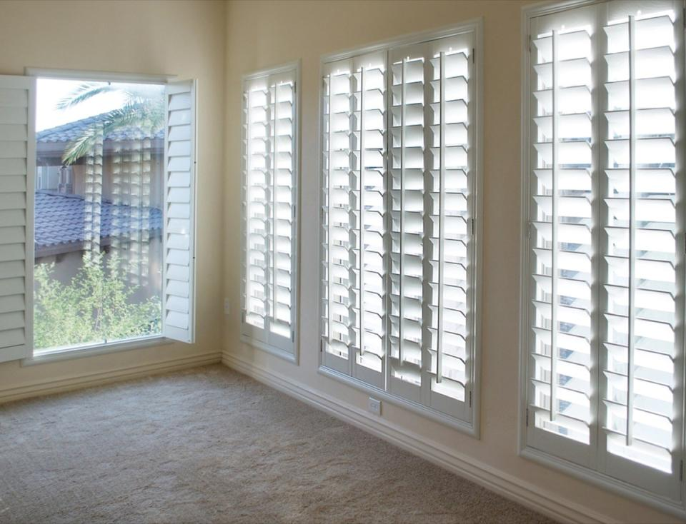 white room with plantation shutters, interior design mistakes