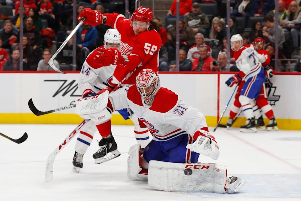 Montreal Canadiens goaltender Carey Price (31) deflects a shot as Detroit Red Wings left wing Tyler Bertuzzi (59) moves for the rebound during the second period on Feb. 18, 2020, in Detroit.