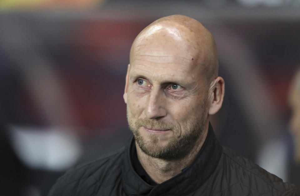 FILE - In this file photo dated Thursday, Sept. 19, 2019, Feyenoord's manager Jaap Stam before the Europa League group G soccer match against Rangers at Ibrox in Glasgow, Scotland. Feyenoord coach Jaap Stam has quit, Monday Oct. 28, 2019, a day after his team slumped to a 4-0 defeat at arch-rival Ajax. (AP Photo/Scott Heppell, FILE)