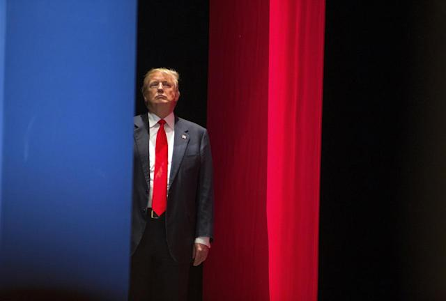 <p>Trump prepares to go onstage to during the Freedom Summit in Greenville, S.C., on May 9, 2015. <i>(Photo: Chris Keane/AP)</i> </p>