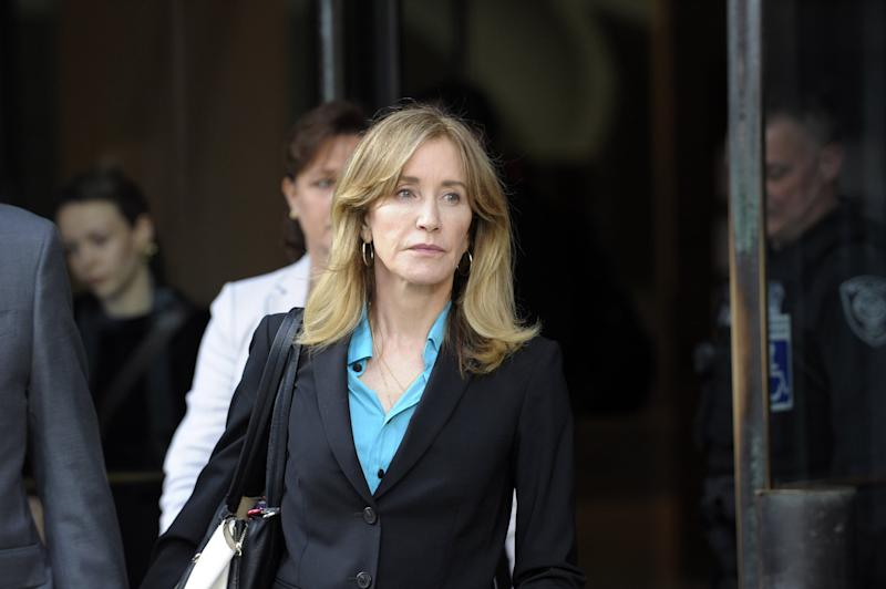 Actress Felicity Huffman exits the courthouse after facing charges for allegedly conspiring to commit mail fraud and other charges in the college admissions scandal at the John Joseph Moakley United States Courthouse in Boston on April 3, 2019. (Photo by Joseph Prezioso / AFP) (Photo credit should read JOSEPH PREZIOSO/AFP/Getty Images)