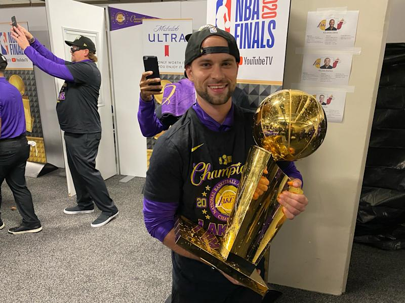 Equipment manager Andrew Henk holds the Larry O'Brien Trophy outside the Los Angeles Lakers' locker room in Orlando. The 29-year-old from Shelby Township was a team manager for Michigan State basketball and an assistant equipment manager with the PIstons before taking over his new job this season.