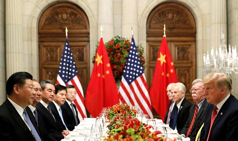 U.S. President Donald Trump, U.S. Secretary of State Mike Pompeo, U.S. President Donald Trump's national security adviser John Bolton and Chinese President Xi Jinping attend a working dinner after the G20 leaders summit in Buenos Aires, Argentina December 1, 2018. Photo: REUTERS/Kevin Lamarque/File Photo