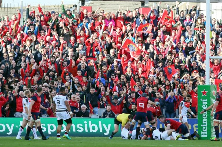 Munster fans celebrate their team's first try during the European Champions Cup quarter-final match against Toulouse, at Thomond Park in Limerick, Ireland, on April 1, 2017
